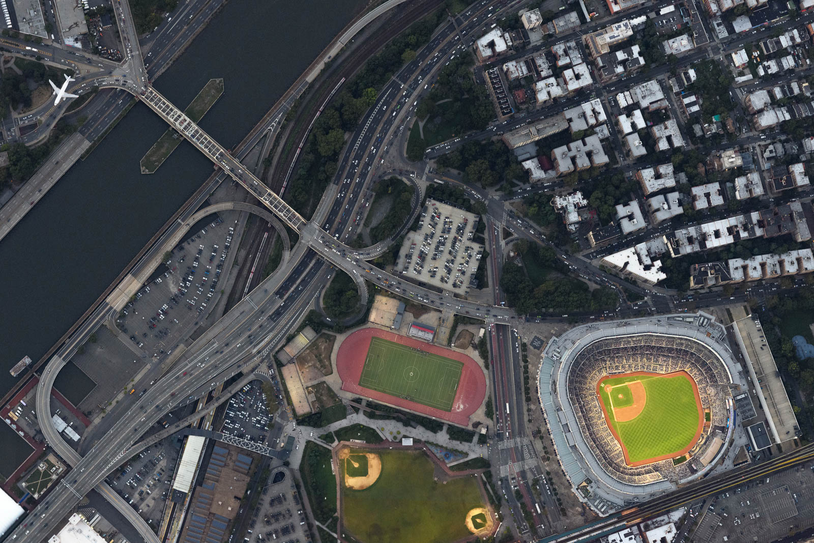 As the Yankees game starts, an airliner arrives to La Guardia airport